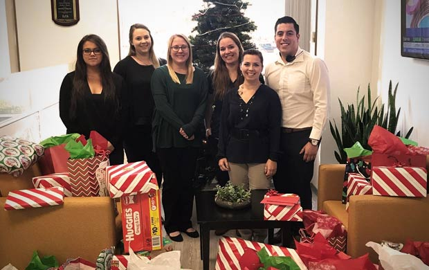 QuickBridge Collaborates with OC United, Adopts Two Families This Holiday Season